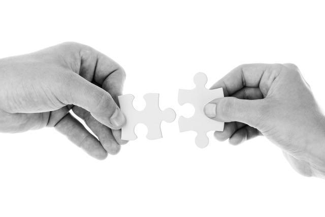 Hands and jigsaw piece